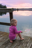 Cute little girl fishing Royalty Free Stock Image