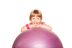 Cute little girl with a fitness ball. Royalty Free Stock Photo