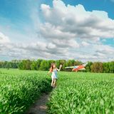 Cute little girl flies a kite Stock Image