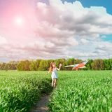 Cute little girl flies a kite Royalty Free Stock Photography