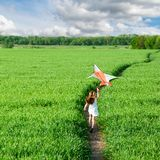 Cute little girl flies a kite Royalty Free Stock Images