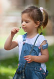Cute little girl with a flower Royalty Free Stock Images