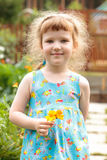 Cute little girl with the flowers Stock Photos