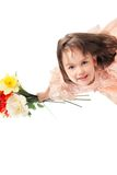 Cute little girl with flowers Stock Photo
