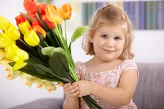 Cute little girl with flowers Stock Photos