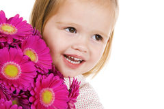 Cute little girl with flowers Stock Image
