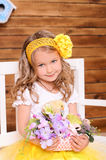 Cute little girl with flowers and alive chicken Royalty Free Stock Images
