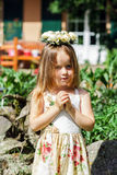 Cute little girl with flowers chaplet Stock Photography