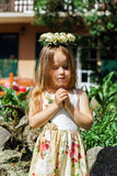 Cute little girl with flowers chaplet Stock Images