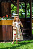 Cute little girl with flowers chaplet Royalty Free Stock Photo