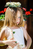 Cute little girl with flowers chaplet Royalty Free Stock Image