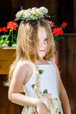 Cute little girl with flowers chaplet Stock Photo