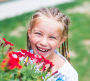 Cute little girl  flowers Stock Photography