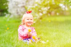 Cute little girl with flowers in spring nature Stock Image