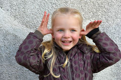 Cute little girl fooling around Royalty Free Stock Photos