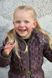Cute little girl fooling around Stock Photo