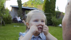 Cute little girl fooling with father stock video footage