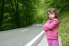 Cute little girl in a forest road Royalty Free Stock Image