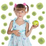 A cute little girl with a fresh apple Royalty Free Stock Photography