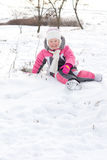 Cute little girl frolicking in snow Stock Image