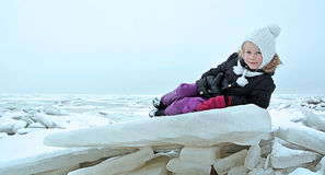 Cute little girl on the frozen sea Stock Photography