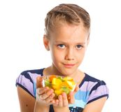 Cute little girl with fruits Royalty Free Stock Photos