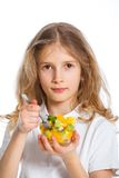 Cute little girl with fruits Stock Photography