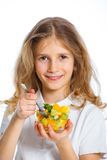 Cute little girl with fruits Stock Images