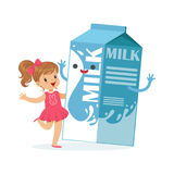 Cute little girl and funny milk carton box with smiling human face playing and having fun, healthy childrens food Stock Photos