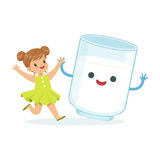 Cute little girl and funny milk glass with smiling human face playing and having fun, healthy childrens food cartoon Stock Photo