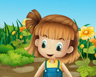 A cute little girl in the garden with blooming flowers Royalty Free Stock Image