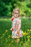 Cute little girl in the garden Royalty Free Stock Photos