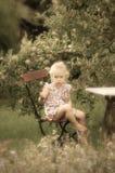 Cute little girl in the garden Stock Image
