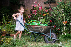 Cute little girl gardening in the backyard Royalty Free Stock Photo