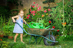 Cute little girl gardening in the backyard Royalty Free Stock Images