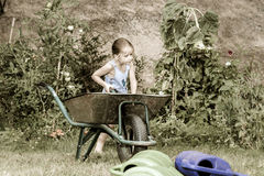Cute little girl gardening in the backyard Royalty Free Stock Image