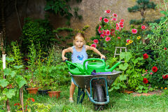 Cute little girl gardening in the backyard Royalty Free Stock Image