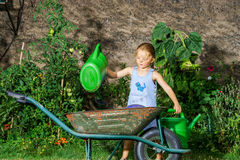 Cute little girl gardening in the backyard Royalty Free Stock Photos