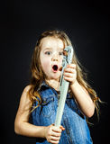 Cute little girl with gas spanner in her hands Stock Images