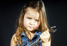 Cute little girl with gas spanner in her hands Royalty Free Stock Image