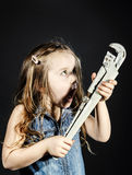 Cute little girl with gas spanner in her hands Stock Photography