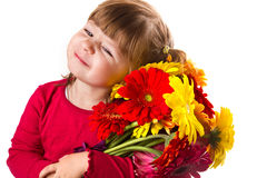 Cute little girl with gerbera flowers bouquet Royalty Free Stock Image