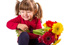 Cute little girl with gerbera flowers bouquet Royalty Free Stock Photos