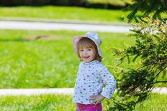 Cute little girl gets dandelion and smiling, happy family having fun  playing outdoor, summer nature Stock Photo