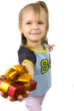 Cute little girl with gift Stock Images