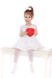 Cute little girl with a gift Royalty Free Stock Images