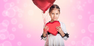 Cute little girl with a gift Stock Photos