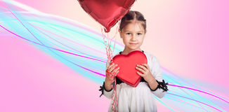 Cute little girl with a gift. Cute little girl with a baloon and a gift Royalty Free Stock Image