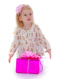 Cute little girl about gift boxes Stock Photo