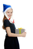 Cute little girl with a gift in hand. Royalty Free Stock Image